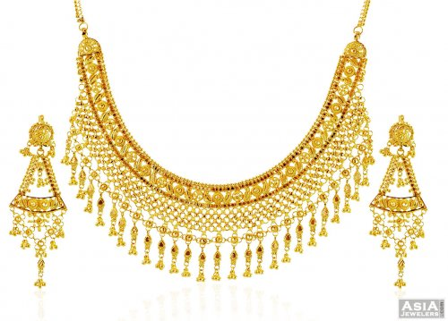 temple gold jewellery haram and clothing necklace indian elegant short